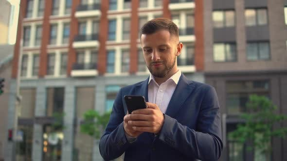 Thumbnail for Guy Receives Messages on His Cell Phone