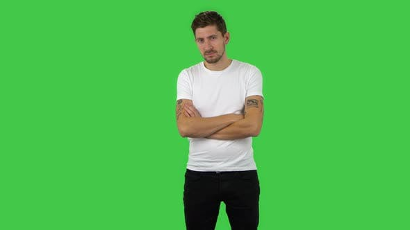 Cover Image for Confident Guy Is Looking Straight and Crossing His Arms Over His Chest. Green Screen