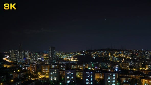 Cover Image for Traffic and House Lights of the City Under the Stars