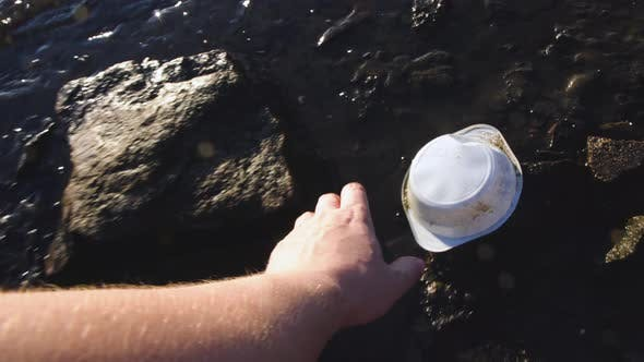 Thumbnail for Man Collecting Plastic Litter on Shore