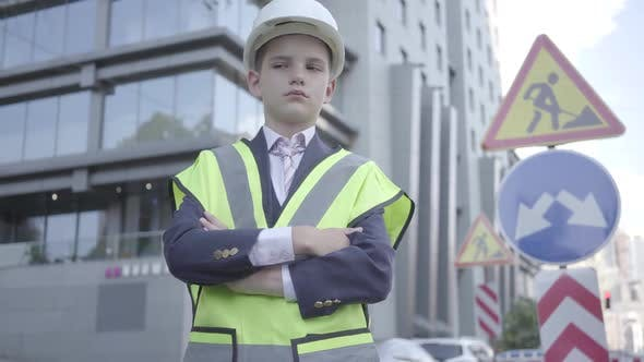 Thumbnail for Portrait Cute Little Successful Boy Wearing Business Suit and Safety Equipment and Constructor