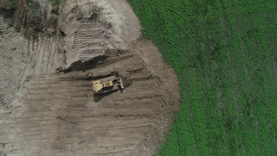 Thumbnail for A Crawler Tractor Pushes The Ground With A Bucket Top View