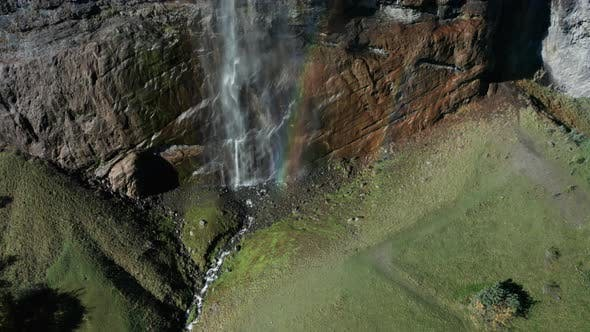 Aerial View of a Waterfall and Rainbow in the Village of Lauterbrunnen. Switzerland in the Fall
