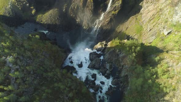 Thumbnail for Voringfossen Waterfall and Cliffs with Trees in Norway