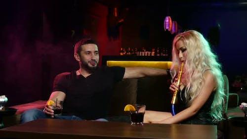 Couple Smoke From Shisha Pipe. Couple Talking