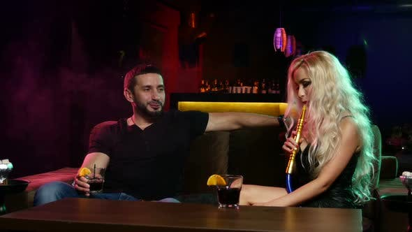 Thumbnail for Couple Smoke From Shisha Pipe. Couple Talking