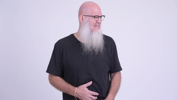 Thumbnail for Stressed Mature Bald Bearded Man Having Stomach Ache