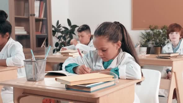Thumbnail for Cute Little Girl Learning in Classroom