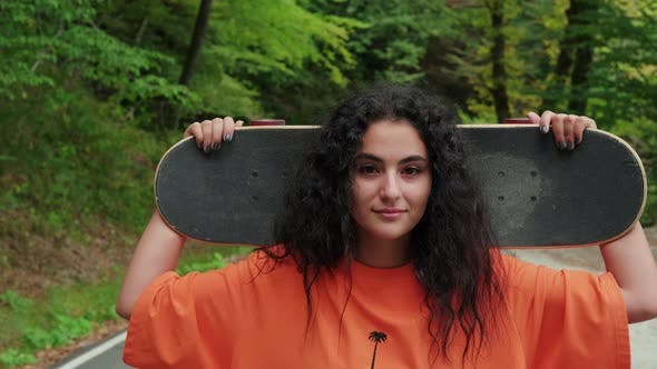 Outdoor Portrait of a Girl Skateboarder