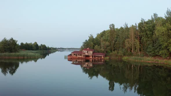 Aerial Shot of Rusty House on Water, Pripyat River