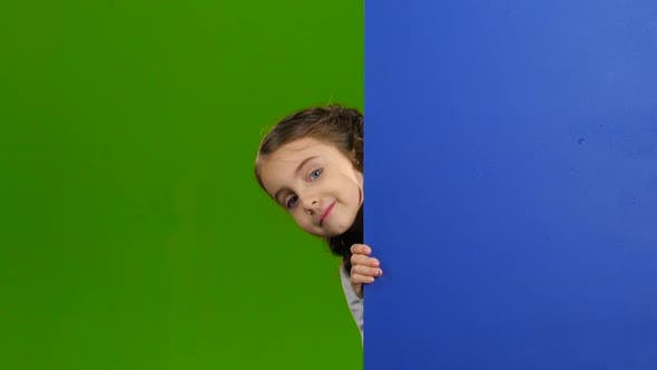 Thumbnail for Baby Looks Out From Behind an Empty Board. Green Screen