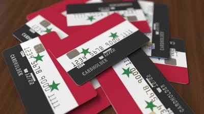 Pile of Credit Cards with Flag of Syria