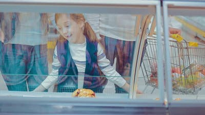 Children with Parents in a Supermarket Chooses Baked Buns