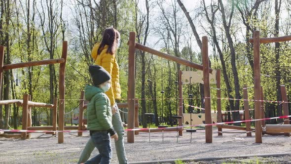 Thumbnail for Family Strolling Near a Closed Playground