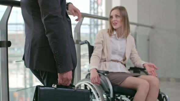 Cover Image for Disabled Businesswoman with Colleague