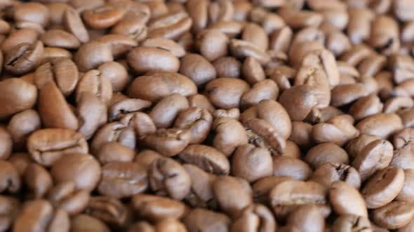 Thumbnail for High quality Arabica type coffee beans on table slow dolly shoot moving 4K 3840X2160 UltraHD footage