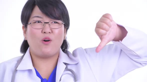 Thumbnail for Face of Stressed Overweight Asian Woman Doctor Getting Bad News
