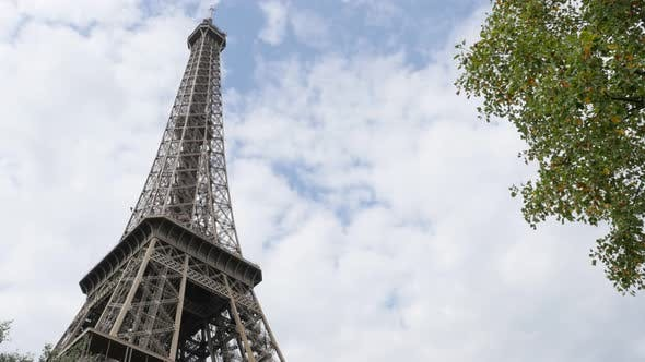 Famous lattice construction of Eiffel tower and symbol of France in front of cloudy sky 4K 2160p Ult