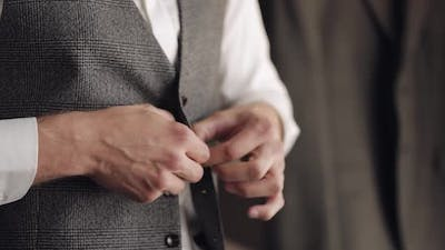 Buttoning Jacket with Hands Close Up Man in Suit Fastens Buttons on His Jacket Preparing to Go Out