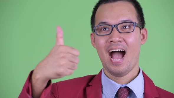 Thumbnail for Face of Happy Asian Businessman with Eyeglasses Giving Thumbs Up