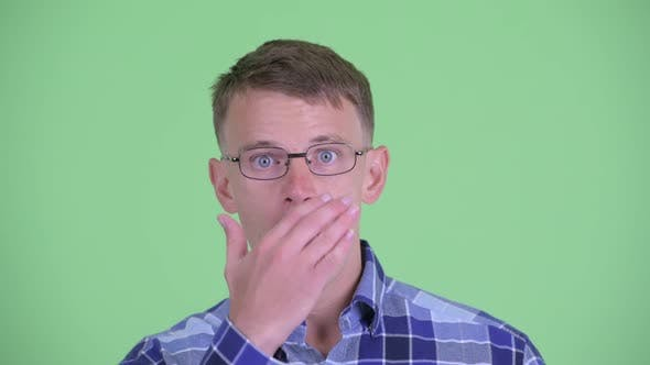 Cover Image for Face of Hipster Man Covering Mouth and Looking Shocked