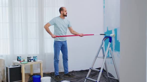 Handyman Renovating House