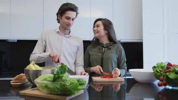 Thumbnail for Couple talking and laughing in the kitchen