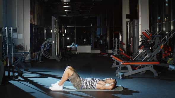 Thumbnail for Muscular Sportsman Doing Sit Ups Exercises Lifting Torso on Floor Mat in Gym Abdominal Crunches