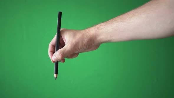 Thumbnail for Man Holding Pencil In His Hand Isolated On Chroma Key Green Screen Background