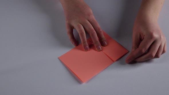 Thumbnail for Woman Makes Paper Windowsill. White. Time Lapse