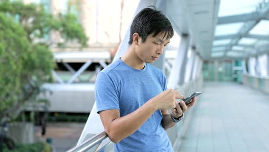 Thumbnail for Man using smart phone in city