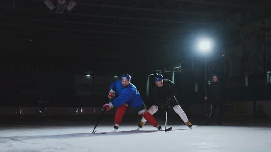 Thumbnail for 2 Hockey Players Fighting for Puck, Legs, Skates Close View