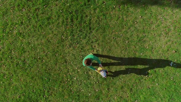 Thumbnail for Aerial view of father rotating infant son at public playground, Zagreb, Croatia.