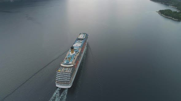 Cover Image for Large Luxury Cruise Liner Is Going in Fjord of Norway. Aerial View. Reveal Shot