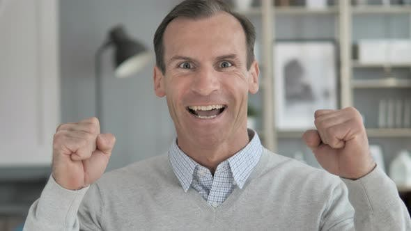Thumbnail for Middle Aged Man Celebrating Success