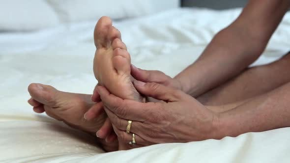Thumbnail for Close up of mature woman massaging feet