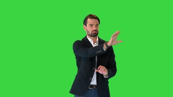 Businessman Touching on a Virtual Screen on a Green Screen Chroma Key