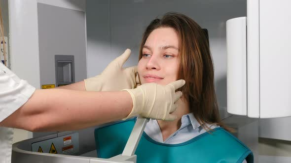 Thumbnail for Doctor Radiologist in Dental Clinic Adjusting Female Patient Head Before MRI Procedure, Dental