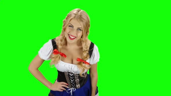 Thumbnail for Bavarian Girl in Bavarian Costume Offers a Beer To Someone. Green Screen