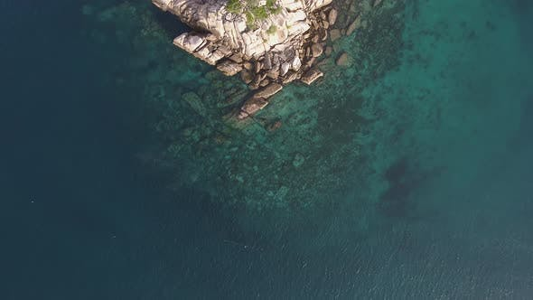 Cover Image for Flying over Small Island in Ocean