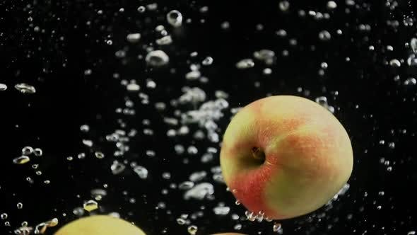 Thumbnail for Red Yellow Apples Falling in Splash of Water Isolated in  on Black Background