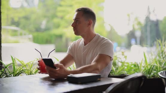 Man Drinking a Grapefruit Lemonade