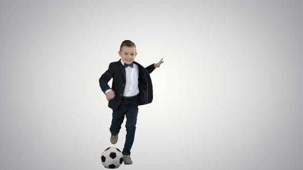 Thumbnail for A cute boy in formal suit hitting a ball on gradient background.