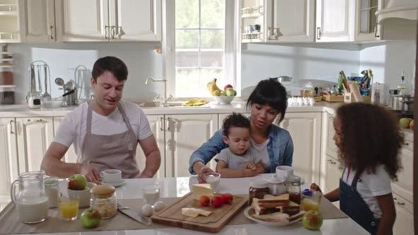 Thumbnail for Family Having Breakfast