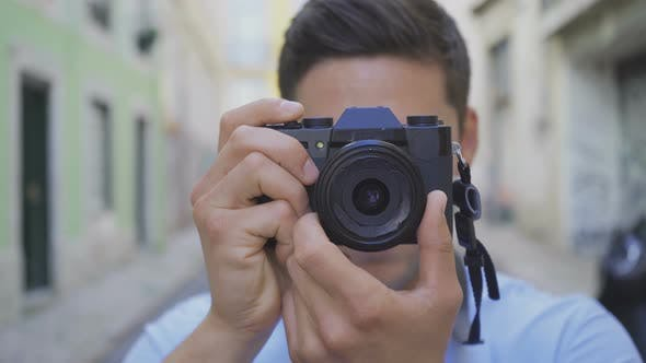 Thumbnail for Cheerful Male Photographer Taking Pictures Outdoor