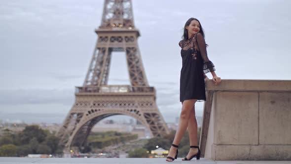 Thumbnail for Parisian woman near the Eiffel tower in Paris, France.