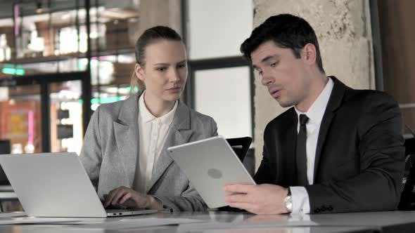 Thumbnail for Business People Working on Laptop and Tablet