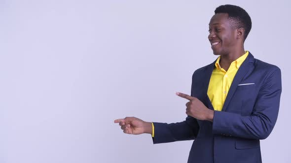 Young Happy African Businessman Pointing Finger and Showing Something
