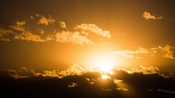 Thumbnail for Dramatic Sunset Over the Clouds. Timelapse. Big Yellow Sun Moves Over the Horizon