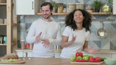 Mixed Race Couple Dancing in Kitchen